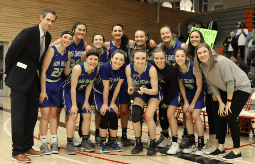 The Big Bend Community College women's basketball team pose with their third place trophy after the last game of the season during the Northwest Athletic Conference Tournament in Everett, WA. In the midst of their historic run, the team still held it down in the classroom recording a 3.65 GPA during the winter 2018 quarter.