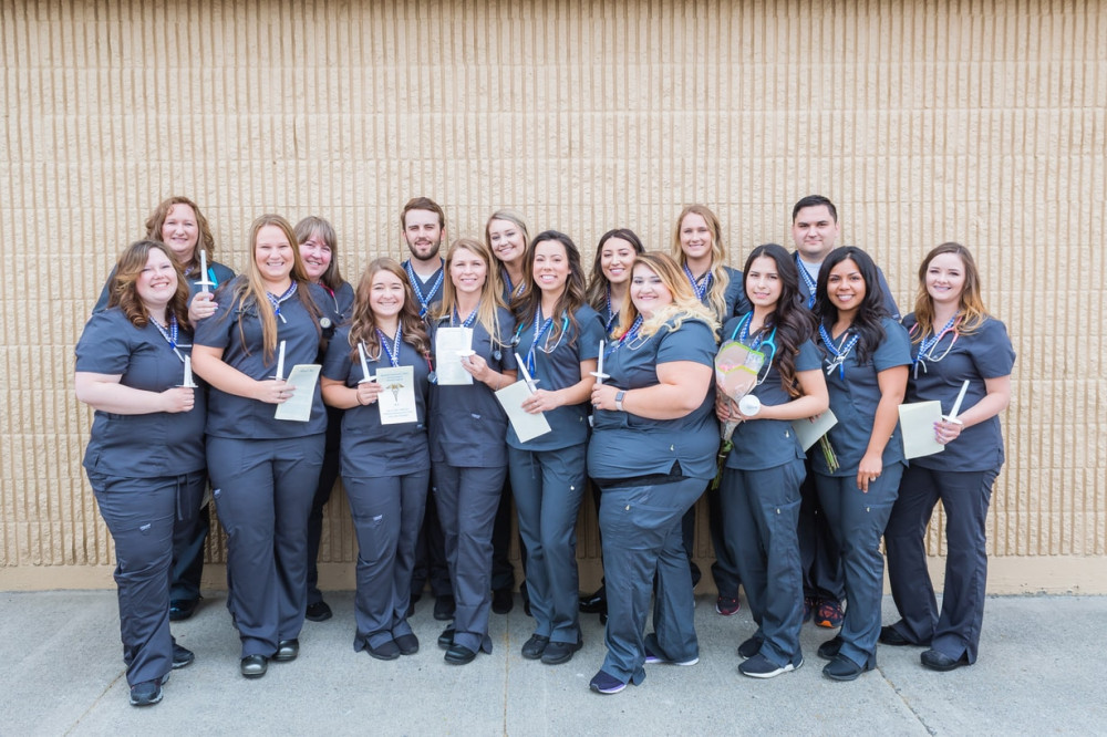Big Bend 2018 nursing program graduates pose for a photo before their official pinning ceremony on June 16. All 16 of the graduates passed the NCLEX-RN licensure exam on their first attempt.