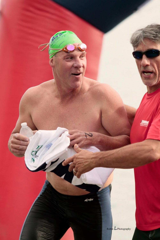 Duane Zamora congratulates swimmer