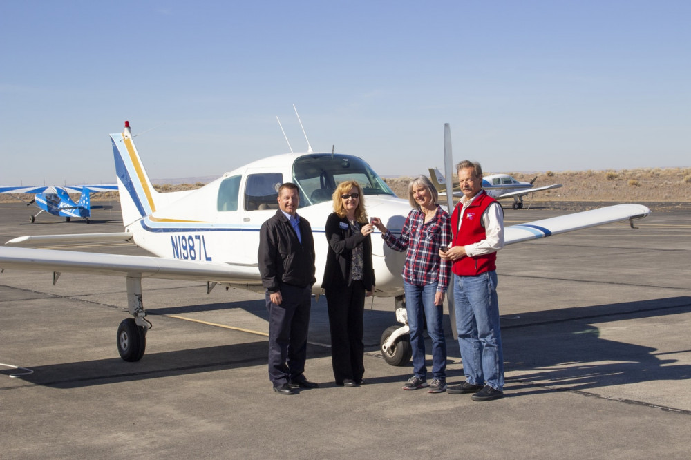 (From left to right) Big Bend Chief Flight Instructor John Marc Swedburg and BBCC Foundation Executive Director LeAnne Parton accept the keys to the Beechcraft Sport B-19 from Ann and Kevin Peterson.