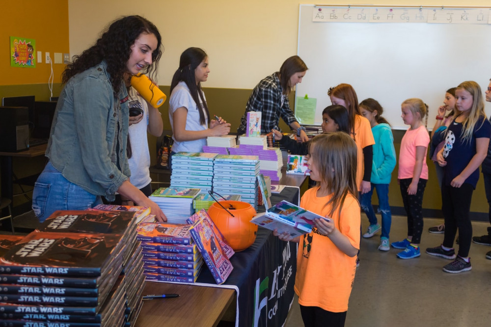 Big Bend Community College ASB officers helped deliver more than 600 books to kids at the Boys and Girls Clubs.